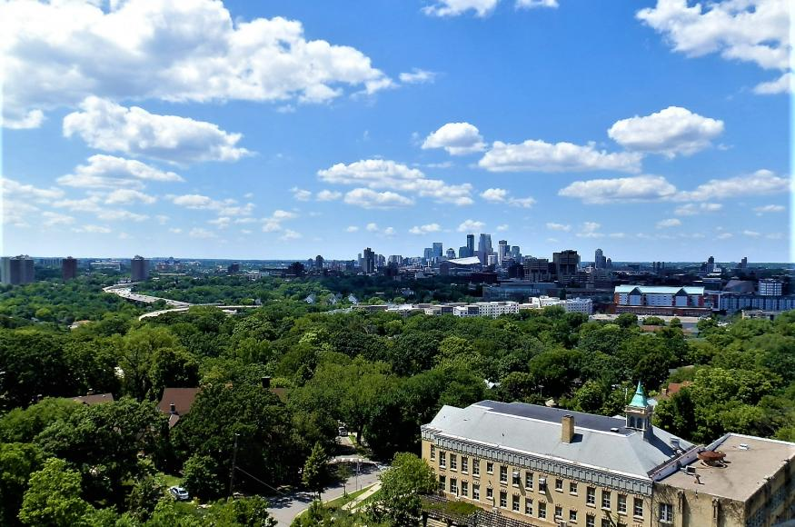 Clouds and tree canopy in Minneapolis taken from Tower Hill